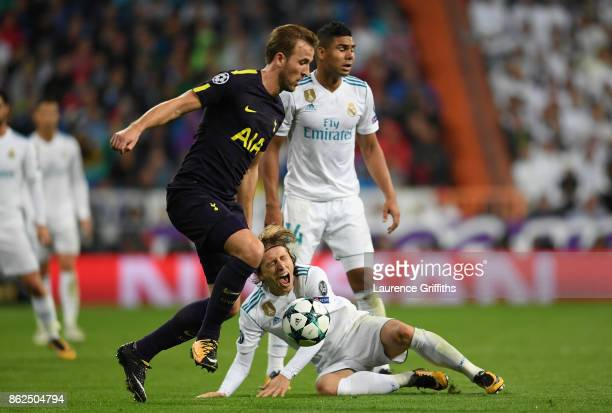 Harry Kane of Tottenham Hotspur and Luka Modric of Real Madrid battle for possession during the UEFA Champions League group H match between Real...