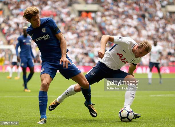 Harry Kane of Tottenham Hotspur and Marcos Alonso of Chelsea in action during the Premier League match between Tottenham Hotspur and Chelsea at...