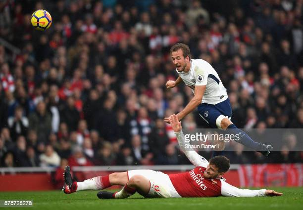 Harry Kane of Tottenham Hotspur and Shkodran Mustafi of Arsenal in action during the Premier League match between Arsenal and Tottenham Hotspur at...