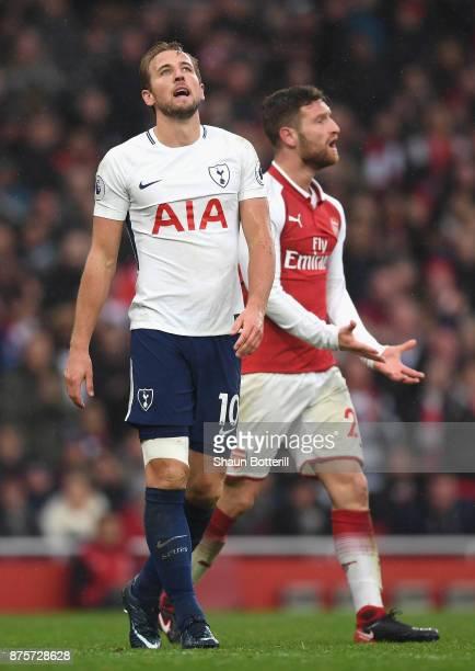 Harry Kane of Tottenham Hotspur and Shkodran Mustafi of Arsenal reacts during the Premier League match between Arsenal and Tottenham Hotspur at...