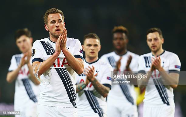 Harry Kane of Tottenham Hotspur and team mates applaud the travelling fans after the UEFA Europa League Round of 16 first leg match between Borussia...