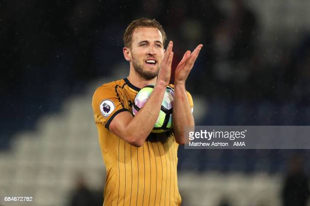 Harry Kane of Tottenham Hotspur applauds the fans with the match ball after his four goals at the end of the Premier League match between Leicester...