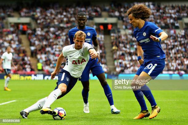Harry Kane of Tottenham Hotspur attempts to dribble past David Luiz of Chelsea during the Premier League match between Tottenham Hotspur and Chelsea...