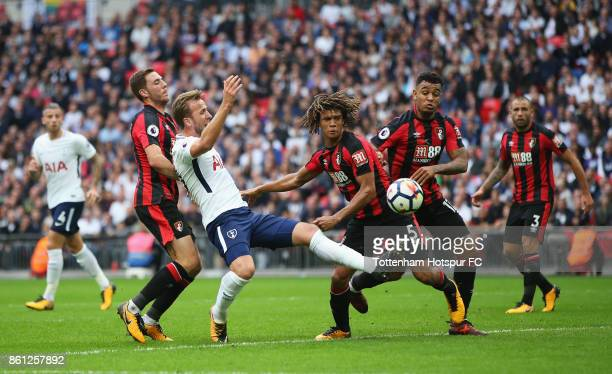 Harry Kane of Tottenham Hotspur battle for possession with Dan Gosling of AFC Bournemouth and Nathan Ake of AFC Bournemouth during the Premier League...