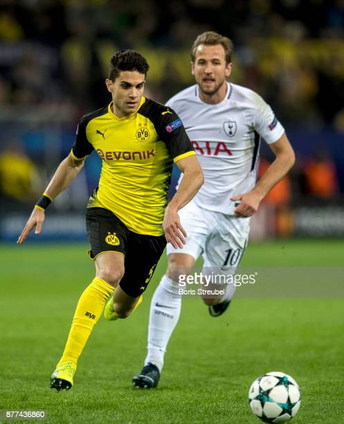 Harry Kane of Tottenham Hotspur battles for the ball with Marc Bartra of Borussia Dortmund during the UEFA Champions League group H match between...