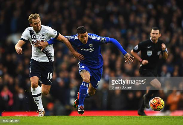Harry Kane of Tottenham Hotspur battles with Kenedy of Chelsea during the Barclays Premier League match between Tottenham Hotspur and Chelsea at...