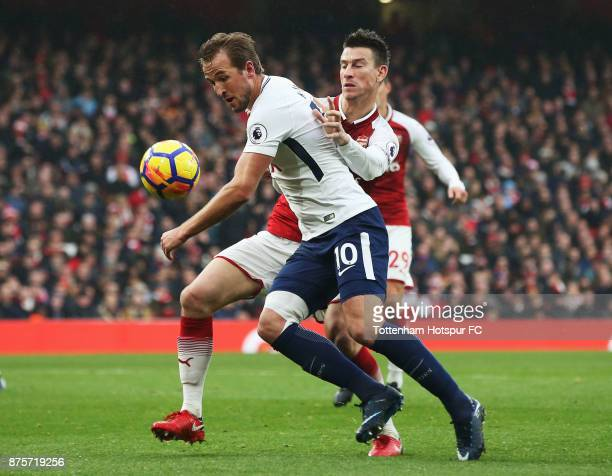 Harry Kane of Tottenham Hotspur battles with Laurent Koscielny of Arsenal during the Premier League match between Arsenal and Tottenham Hotspur at...