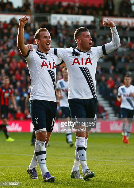 Harry Kane of Tottenham Hotspur celeberates scoring his team's fifth and hat trick goal with his team mate Toby Alderweireld during the Barclays...