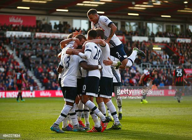 Harry Kane of Tottenham Hotspur celeberates scoring his team's fifth and hat trick goal with his team mates during the Barclays Premier League match...