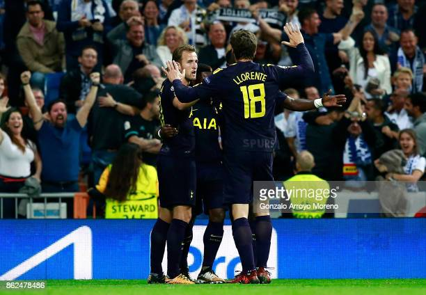 Harry Kane of Tottenham Hotspur celebrates after Raphael Varane of Real Madrid scores a own goal for Tottenham Hotspur with his Tottenham Hotspur...