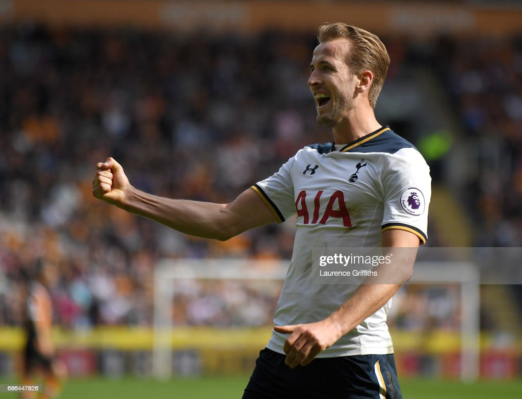 Harry Kane of Tottenham Hotspur celebrates after scoring a hat-trick and winning the Premier League Golden Boot award during the Premier League match between Hull City and Tottenham Hotspur at KC Stadium on May 21, 2017 in Hull, England.