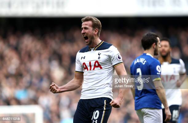 Harry Kane of Tottenham Hotspur celebrates after scoring his sides first goal during the Premier League match between Tottenham Hotspur and Everton...