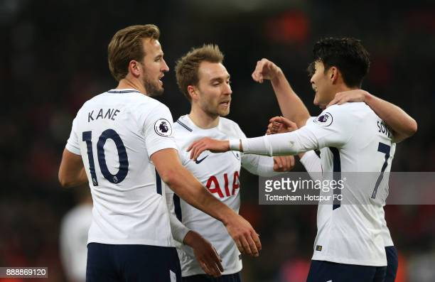 Harry Kane of Tottenham Hotspur celebrates after scoring his sides fourth goal with Christian Eriksen of Tottenham Hotspur and Harry Kane of...