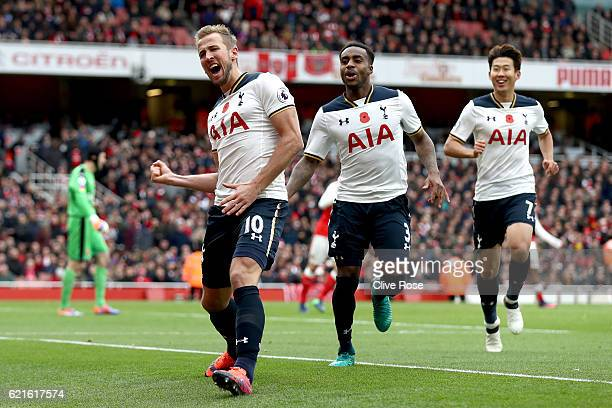 Harry Kane of Tottenham Hotspur celebrates scoring his sides first goal with team mates during the Premier League match between Arsenal and Tottenham...