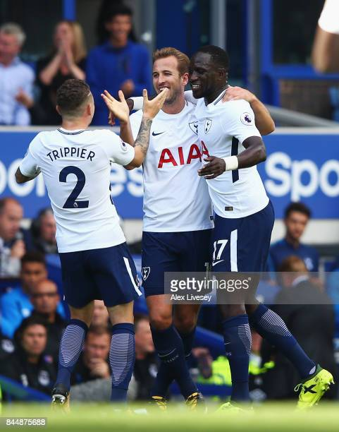 Harry Kane of Tottenham Hotspur celebrates scoring his sides first goal with Moussa Sissoko of Tottenham Hotspur and Kieran Trippier of Tottenham...