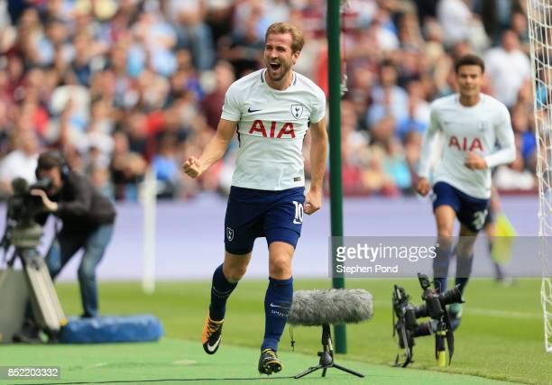 Harry Kane of Tottenham Hotspur celebrates scoring his sides first goal during the Premier League match between West Ham United and Tottenham Hotspur...