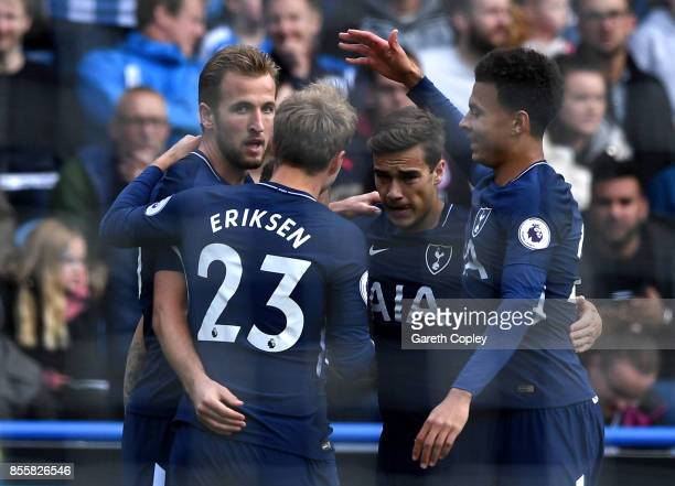 Harry Kane of Tottenham Hotspur celebrates scoring his sides first goal with his Tottenham Hotspur team mates during the Premier League match between...