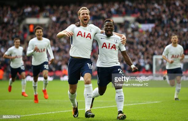 Harry Kane of Tottenham Hotspur celebrates scoring his sides first goal with Serge Aurier of Tottenham Hotspur during the Premier League match...