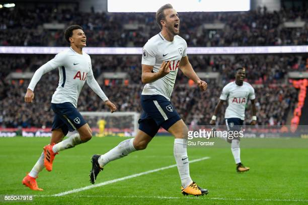 Harry Kane of Tottenham Hotspur celebrates scoring his sides fourth goal with Dele Alli of Tottenham Hotspur during the Premier League match between...