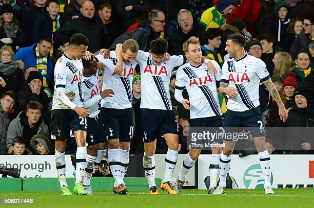 Harry Kane of Tottenham Hotspur celebrates scoring his team's second goal with his team mates during the Barclays Premier League match between...