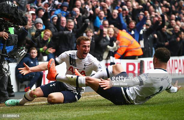 Harry Kane of Tottenham Hotspur celebrates scoring his team's second goal with his team mate Kyle Walker during the Barclays Premier League match...