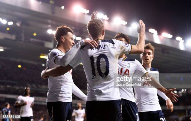 Harry Kane of Tottenham Hotspur celebrates scoring the first goal with team mates during the Premier League match between Tottenham Hotspur and...