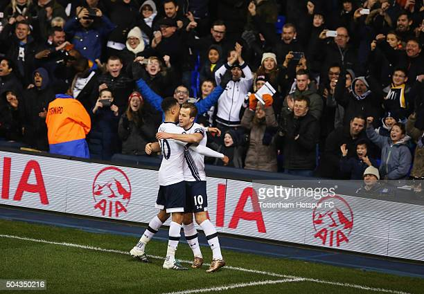 Harry Kane of Tottenham Hotspur celebrates with Dele Alli in front of the Spurs fans as he scores their second goal from a penalty during the...