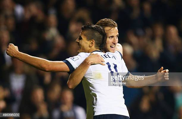 Harry Kane of Tottenham Hotspur celebrates with Erik Lamela as he scores their third goal during the Barclays Premier League match between Tottenham...