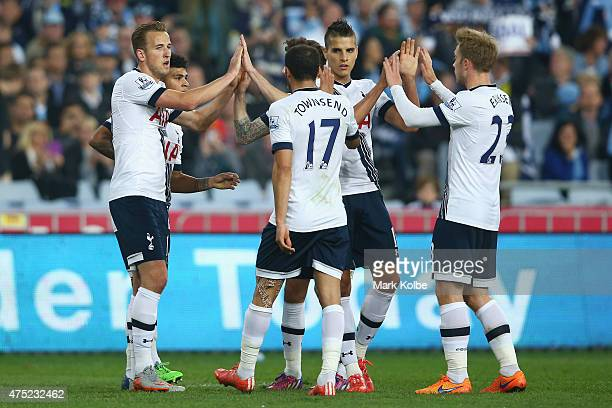 Harry Kane of Tottenham Hotspur celebrates with his team mates after scoring a goal during the international friendly match between Sydney FC and...