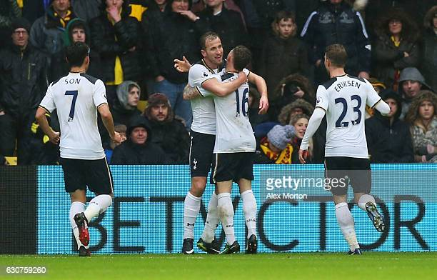 Harry Kane of Tottenham Hotspur celebrates with Kieran Trippier as he scores their first goal during the Premier League match between Watford and...