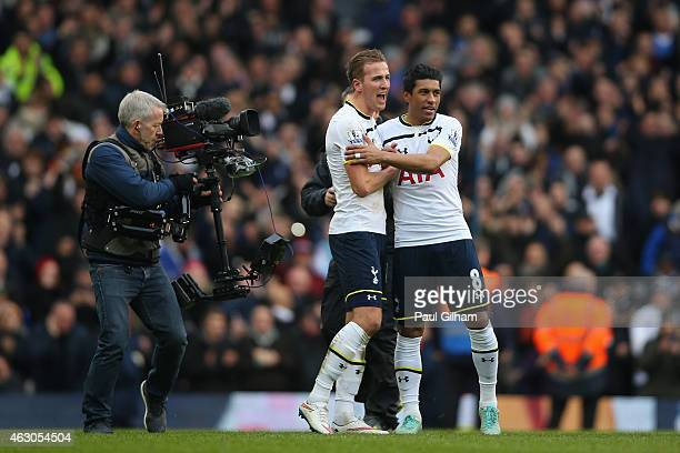 Harry Kane of Tottenham Hotspur celebrates with Paulino as a television camera films him at the end of the Barclays Premier League match between...