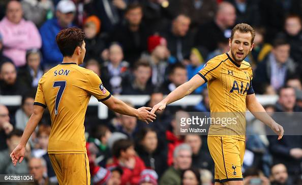 Harry Kane of Tottenham Hotspur celebrates with team mate HeungMin Son as he scores their third goal and completes his hat trick during The Emirates...