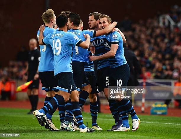 Harry Kane of Tottenham Hotspur celebrates with team mates as he scores their first goal during the Barclays Premier League match between Stoke City...