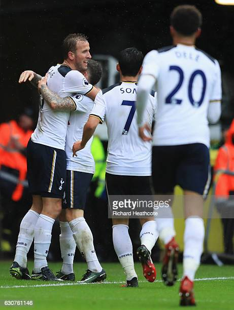 Harry Kane of Tottenham Hotspur celebrates with team mates as he scores their second goal during the Premier League match between Watford and...