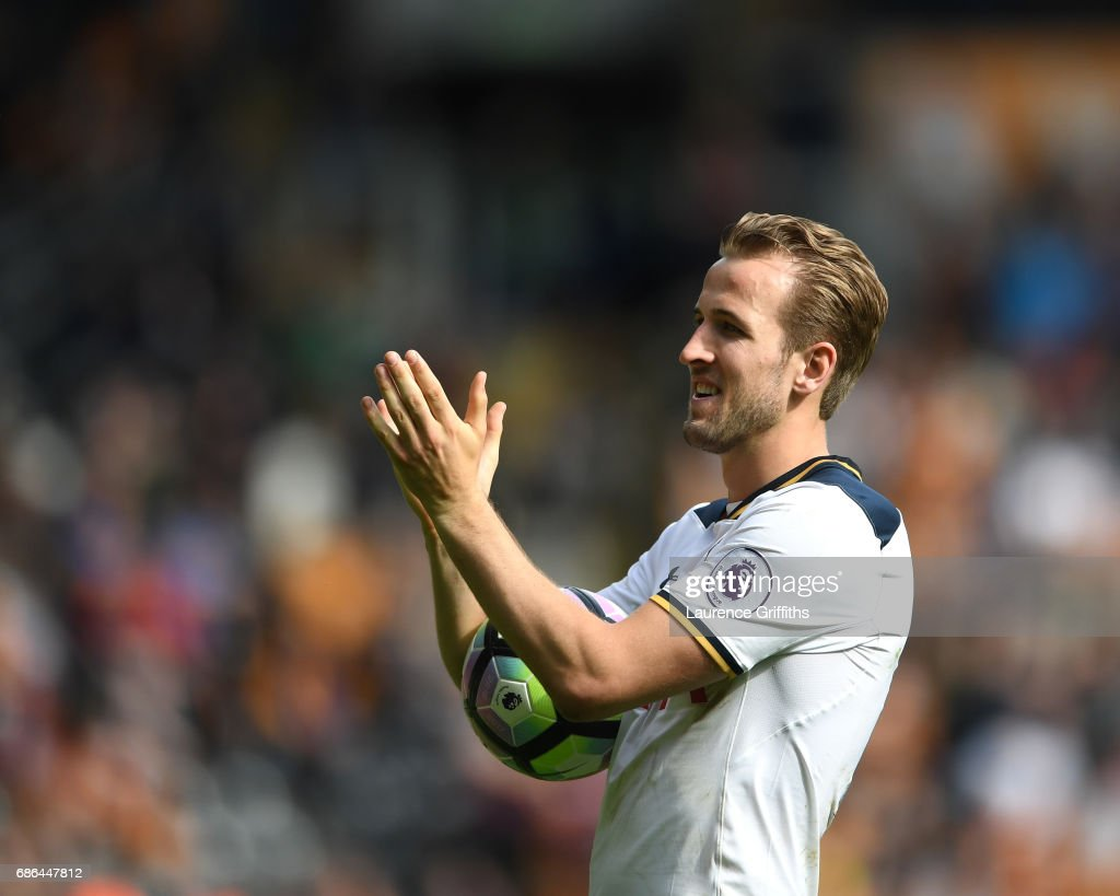 Harry Kane of Tottenham Hotspur celebrates with the fans after scoring a hat-trick and winning the Premier League Golden Boot award during the Premier League match between Hull City and Tottenham Hotspur at KC Stadium on May 21, 2017 in Hull, England.