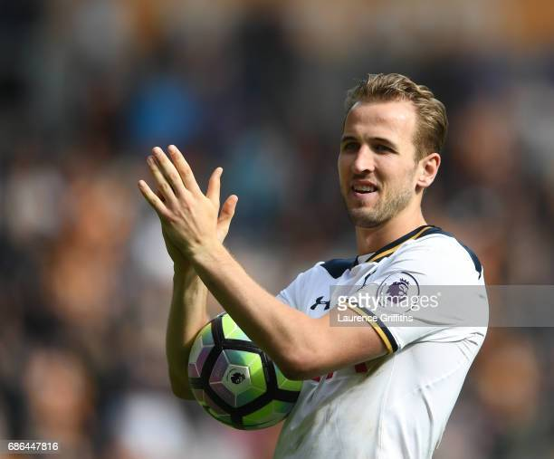 Harry Kane of Tottenham Hotspur celebrates with the fans after scoring a hattrick and winning the Premier League Golden Boot award during the Premier...