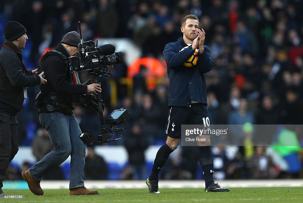 Harry Kane of Tottenham Hotspur collects the match ball after the game and shows appreciation to the fans during the Premier League match between Tottenham Hotspur and West Bromwich Albion at White Hart Lane on January 14, 2017 in London, England.