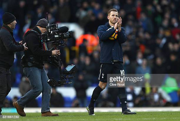 Harry Kane of Tottenham Hotspur collects the match ball after the game and shows appreciation to the fans during the Premier League match between...