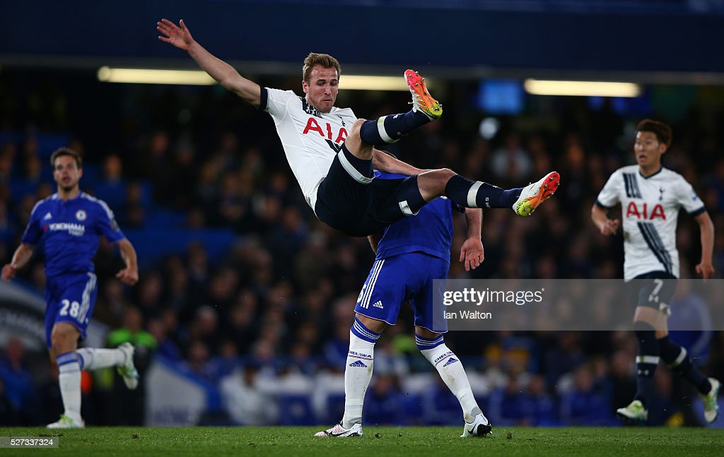 Harry Kane of Tottenham Hotspur collides with John Terry of Chelsea during the Barclays Premier League match between Chelsea and Tottenham Hotspur at Stamford Bridge on May 02, 2016 in London, England.