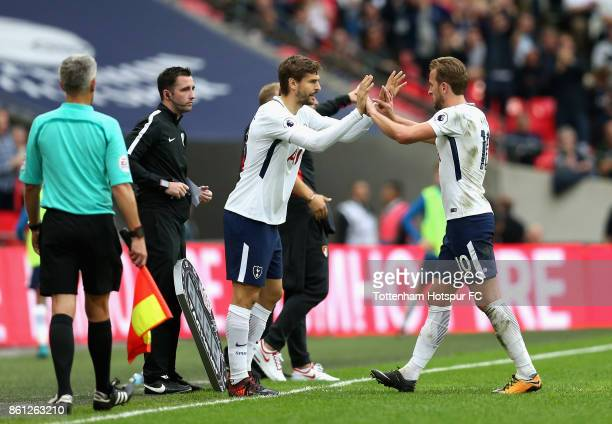 Harry Kane of Tottenham Hotspur comes off for Fernando Llorente of Tottenham Hotspur during the Premier League match between Tottenham Hotspur and...