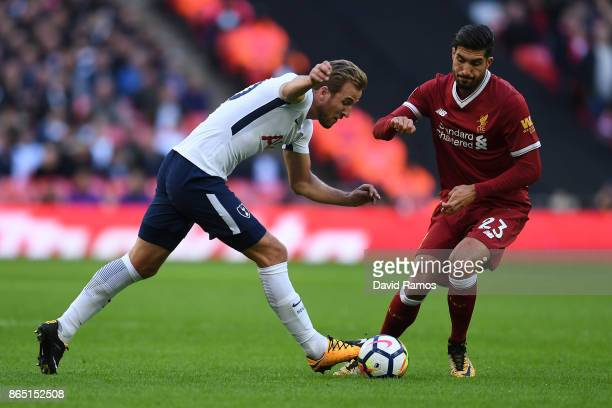 Harry Kane of Tottenham Hotspur competes for the ball with Emre Can of Liverpool during the Premier League match between Tottenham Hotspur and...