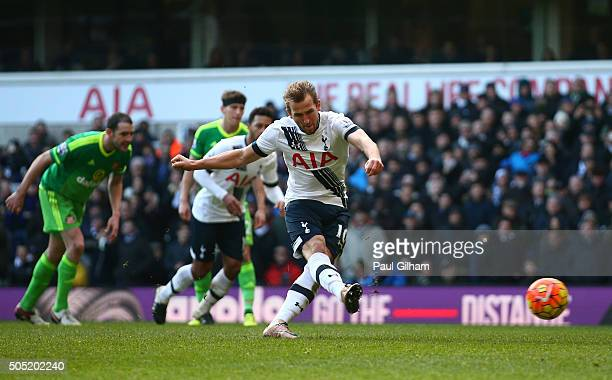 Harry Kane of Tottenham Hotspur converts the penalty kick to score his team's fourth goal during the Barclays Premier League match between Tottenham...