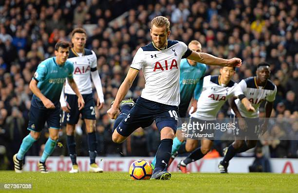 Harry Kane of Tottenham Hotspur converts the penalty to score the opening goal during the Premier League match between Tottenham Hotspur and Swansea...