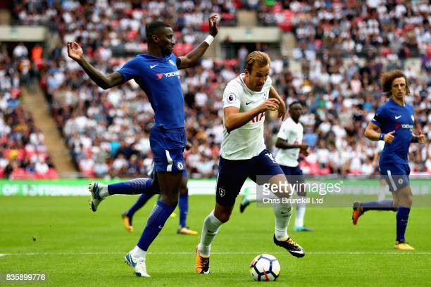 Harry Kane of Tottenham Hotspur dribbles past Antonio Rudiger of Chelsea during the Premier League match between Tottenham Hotspur and Chelsea at...