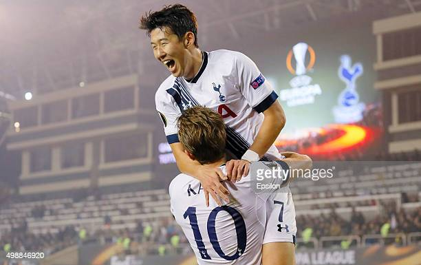 Harry Kane of Tottenham Hotspur FC is congratulated on scoring the opening goal by Son Heungmin during the UEFA Europe League match between Qarabag...