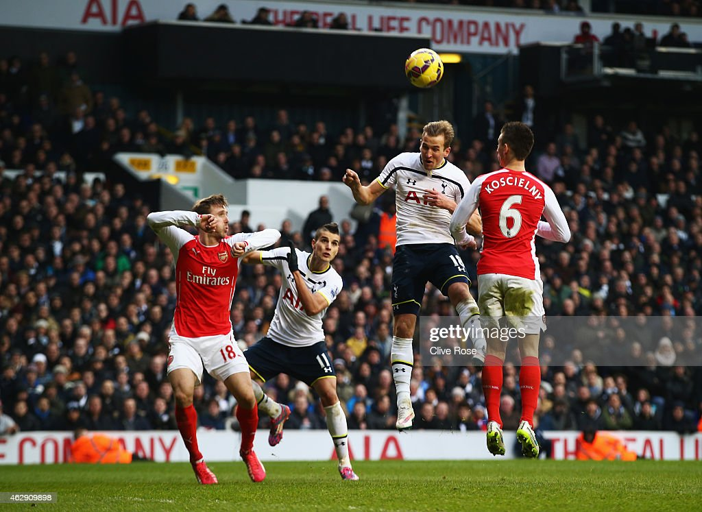 Harry Kane of Tottenham Hotspur heads the winning goal during the Barclays Premier League match between Tottenham Hotspur and Arsenal at White Hart...