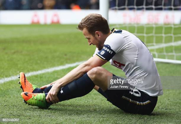 Harry Kane of Tottenham Hotspur holds his ankle during The Emirates FA Cup QuarterFinal match between Tottenham Hotspur and Millwall at White Hart...