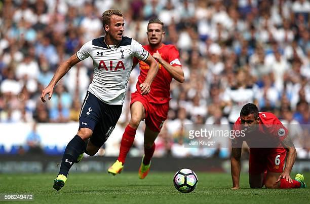 Harry Kane of Tottenham Hotspur holds off Dejan Lovren of Liverpool during the Premier League match between Tottenham Hotspur and Liverpool at White...