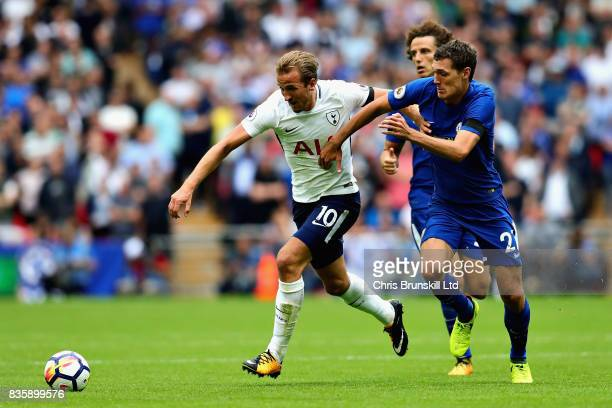 Harry Kane of Tottenham Hotspur is challenged by Andreas Christensen of Chelsea during the Premier League match between Tottenham Hotspur and Chelsea...