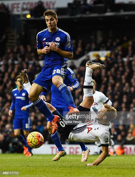 Harry Kane of Tottenham Hotspur is challenged by Cesar Azpilicueta of Chelsea during the Barclays Premier League match between Tottenham Hotspur and...